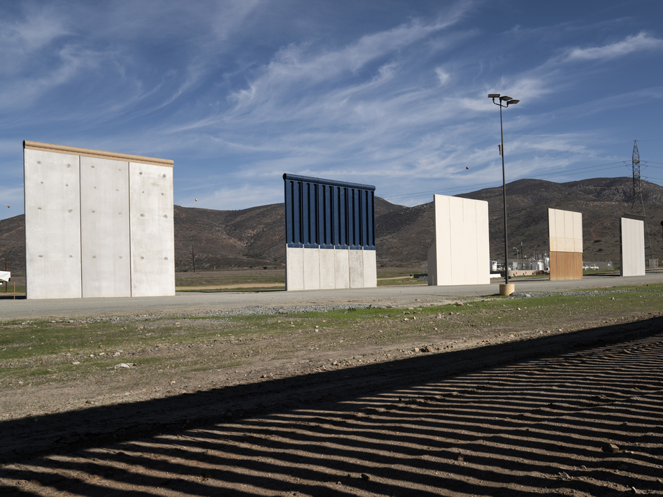 Border wall prototypes stand in San Diego near the U.S.-Mexico border. The federal government remains partially closed in a protracted standoff over President Trump's demand for money to build the wall. (Daniel Ochoa de Olza/AP)