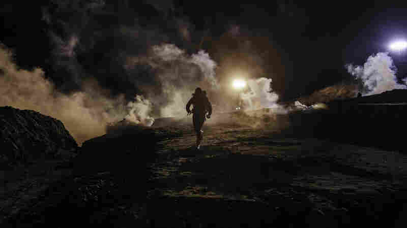 U.S. Agents Fire Tear Gas At Migrants Trying To Cross Mexico Border