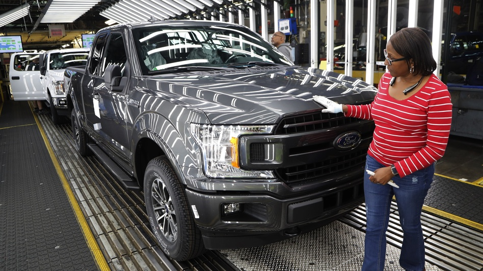 Worker Kelly Coman inspects an F-150 pickup on the assembly line at a Ford plant in Dearborn, Mich. Some indicators point to a slowdown in manufacturing, but the sector added 32,000 jobs in December.