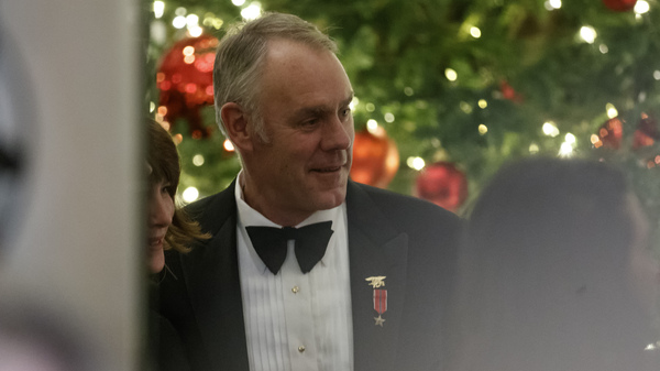 Secretary of the Interior Ryan Zinke attends the Congressional Ball in the Grand Foyer of the White House in December 2018. He resigned that month amid ethics concerns.