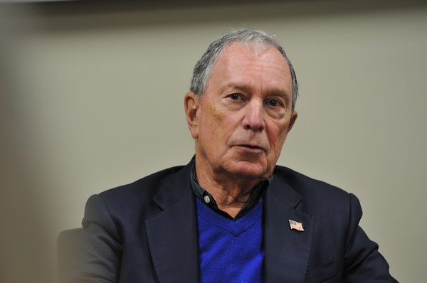 Former New York Mayor Mike Bloomberg meets with local business owners and activists after touring an electric company in Cedar Rapids, Iowa, in December.