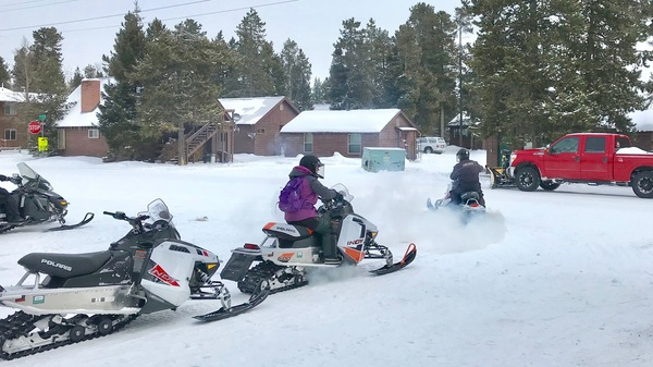 Between 20,000 to 30,000 people visit Yellowstone National Park each month in the winter, many to snowmobile the park