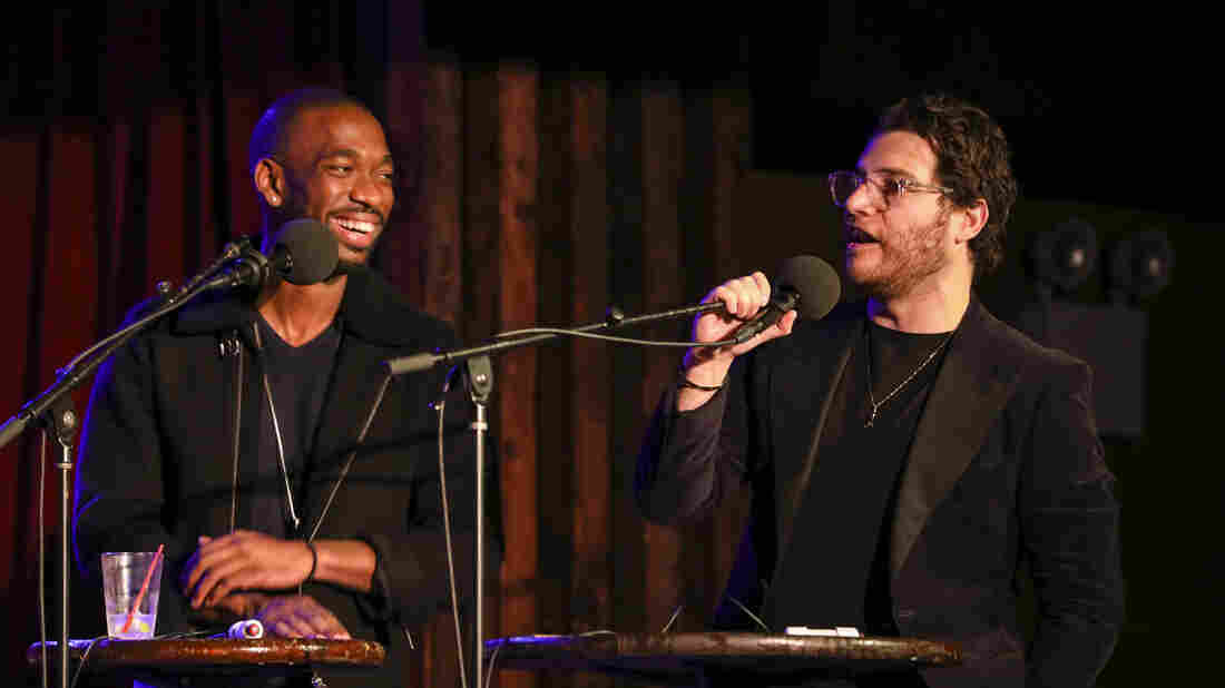 Ask Me Another guests Jay Pharoah and Adam Pally play a game at the Bell House in Brooklyn, New York.