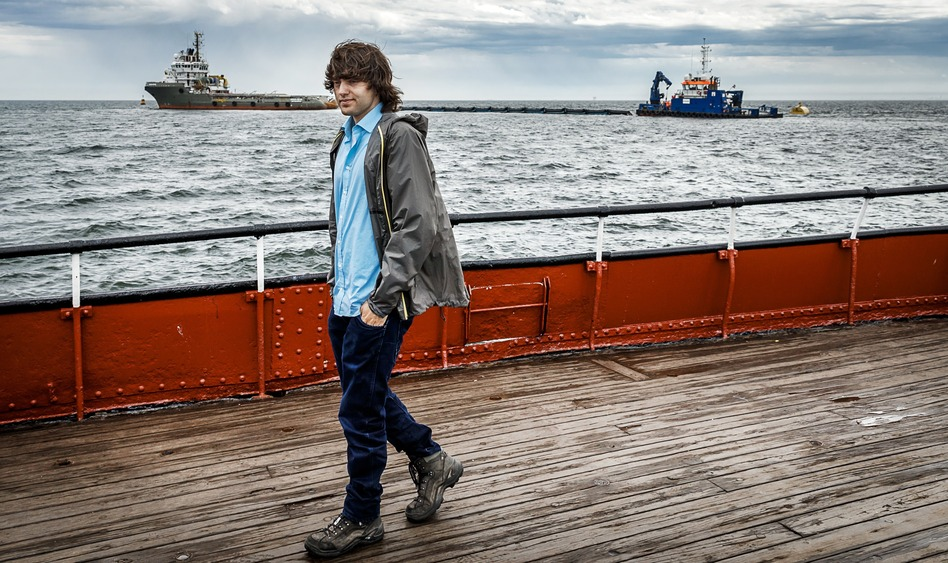 Boyan Slat walks in front of his first prototype ocean cleanup device on June 23, 2016.