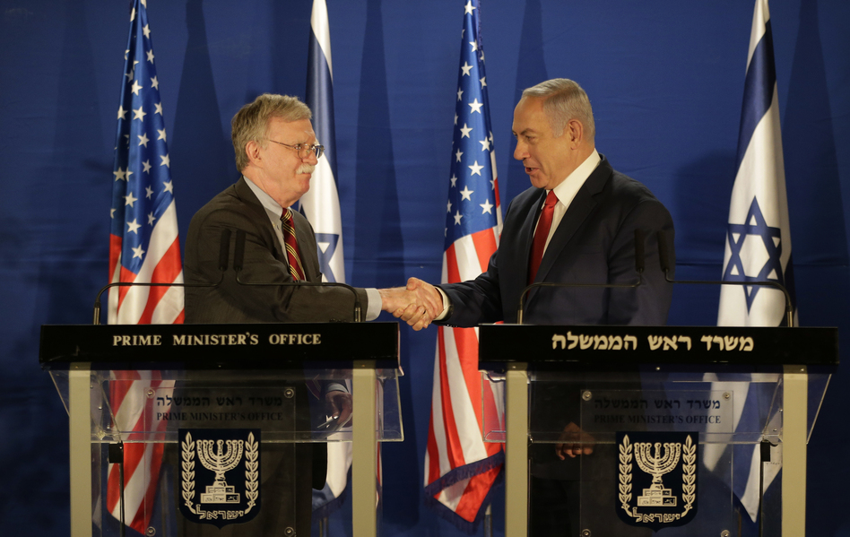 U.S. National Security Advisor John Bolton (left) and Israeli Prime Minister Benjamin Netanyahu shake hands during a joint statement to the media follow their meeting, in Jerusalem on Sunday. (Oded Balilty/AP)