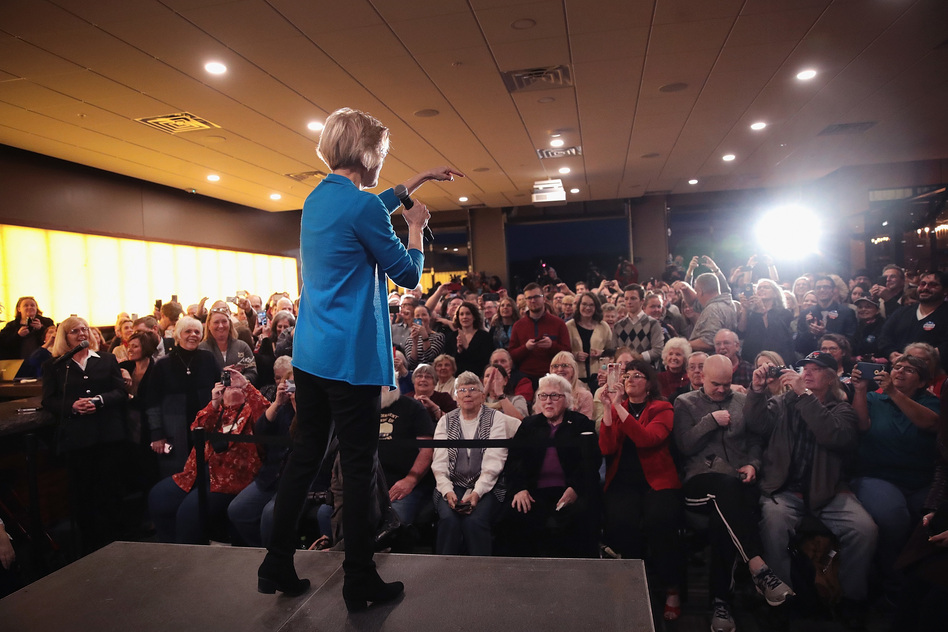 Sen. Elizabeth Warren, D-Mass., speaks to potential voters during a campaign stop on Friday in Council Bluffs, Iowa. (Scott Olson/Getty Images)