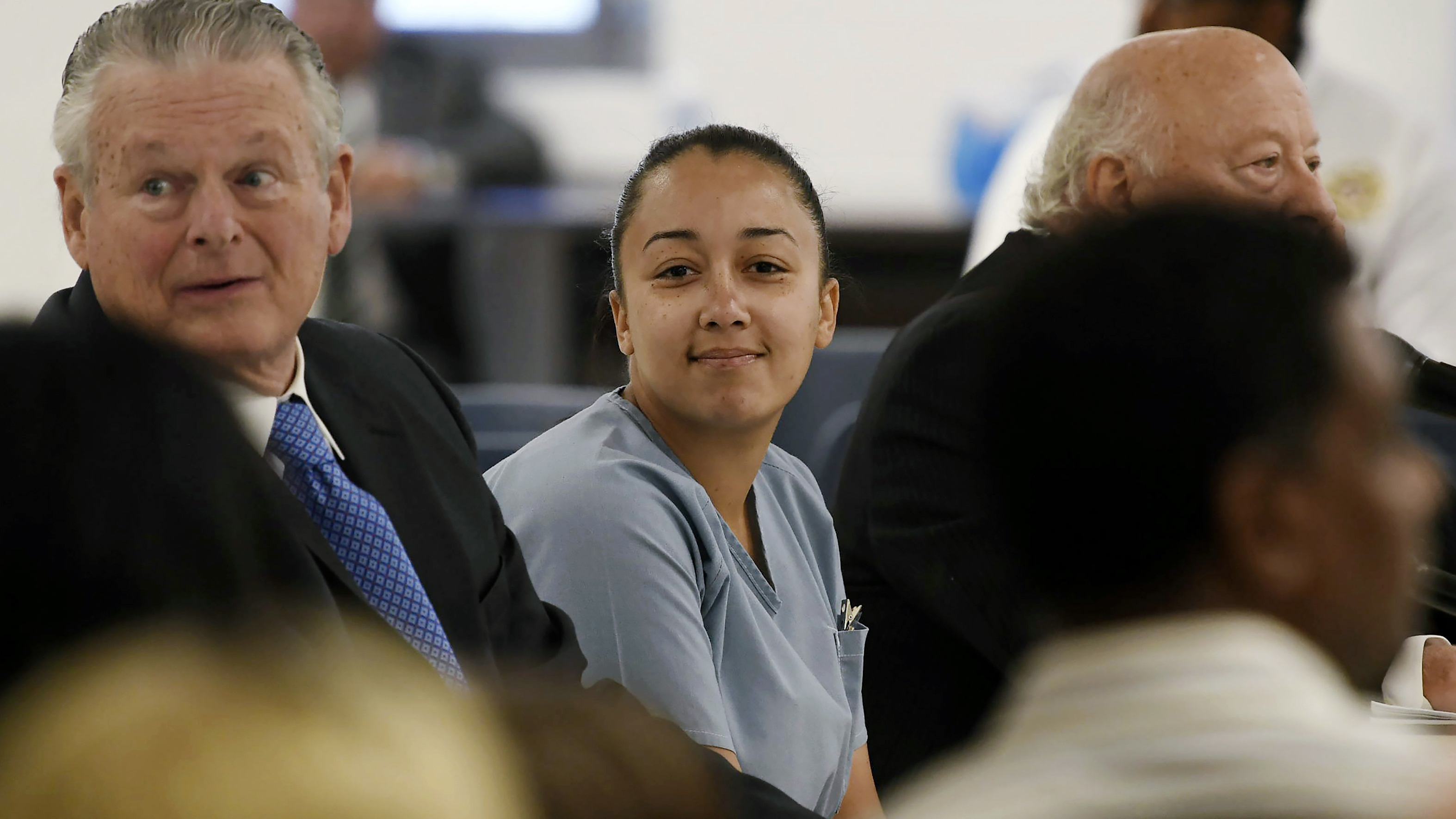 Cyntoia Brown, who was sentenced to a life prison term for killing a man when she was 16, says she will help others avoid the situation she found herself in. She's seen here looking at family members during a clemency hearing in May 2018.