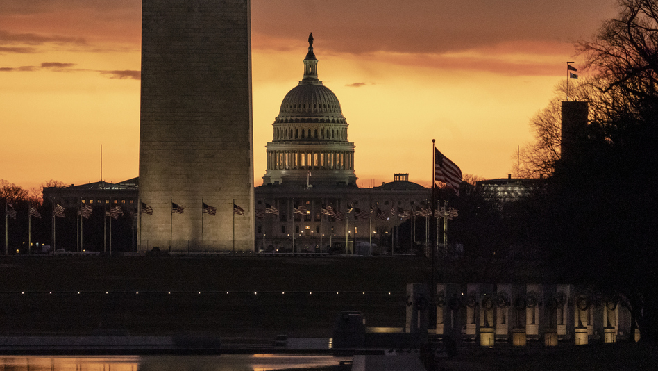 The Capitol and Washington Monument are seen at dawn on Monday. (J. Scott Applewhite/AP)