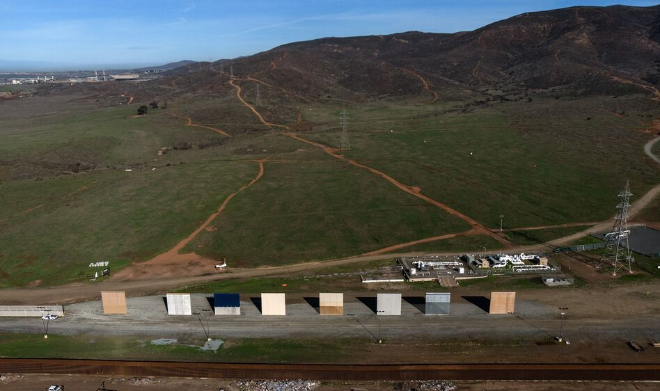 President Trump's border wall prototypes are seen from Tijuana in Baja California state, Mexico, on Monday. Trump has said he may invoke emergency powers to build a border wall if Congress doesn't agree to his demand for funding. (Guillermo Arias/AFP/Getty Images)