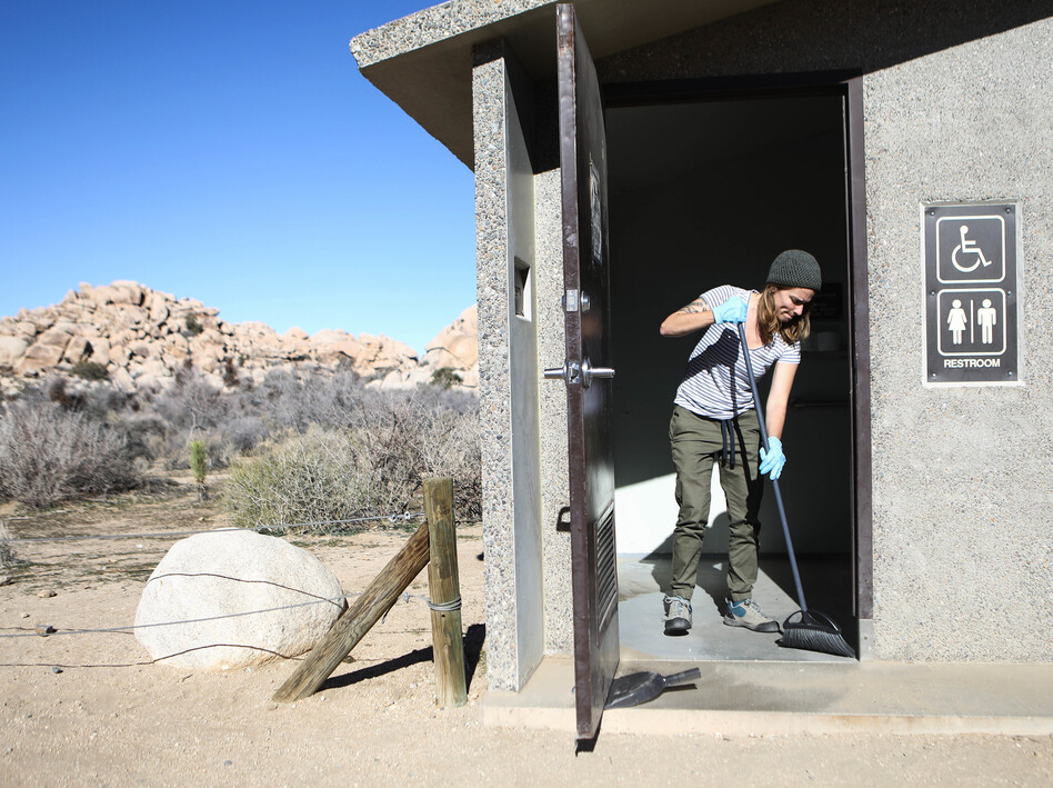 Volunteer Alexandra Degen cleans a restroom during the government shutdown at Joshua Tree National Park in California. (Mario Tama/Getty Images)