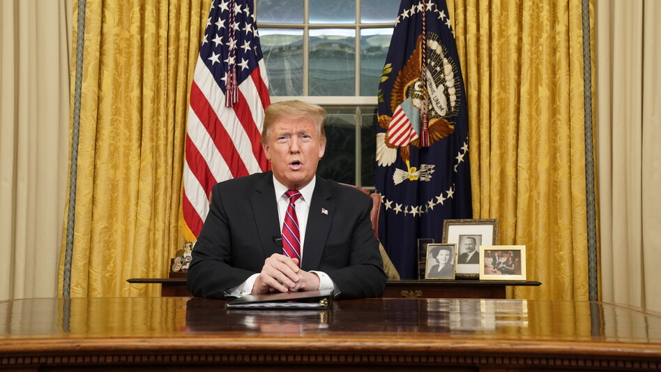 President Trump speaks to the nation in his first televised address from the Oval Office of the White House on Tuesday. (Carlos Barria/Pool/Getty Images)