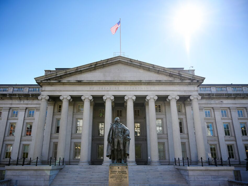 A downgrade in the nation's credit rating could lead to higher borrowing costs for the U.S. Treasury, companies and consumers. (Mandel Ngan/AFP/Getty Images)