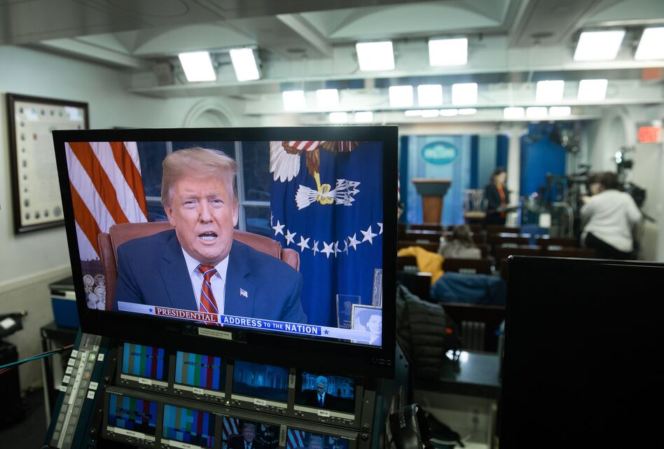President Trump appears on a monitor in the Press Briefing Room of the White House on Tuesday. (Saul Loeb/AFP/Getty Images)