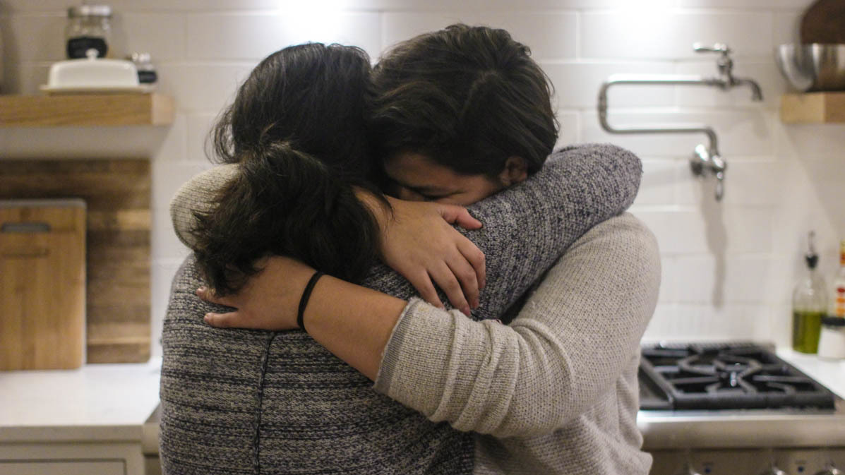 Maria Rivas and her 15-year-old daughter, Emily, embrace after their StoryCorps interview last month.