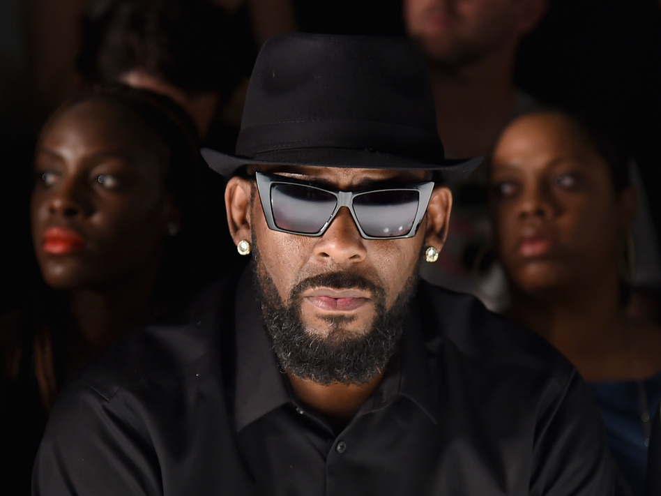Through years of sexual misconduct accusations, rhythm and blues superstar R. Kelly has denied any wrongdoing. Here he attends a show at New York Fashion Week in July 2015. (Michael Loccisano/Getty Images)