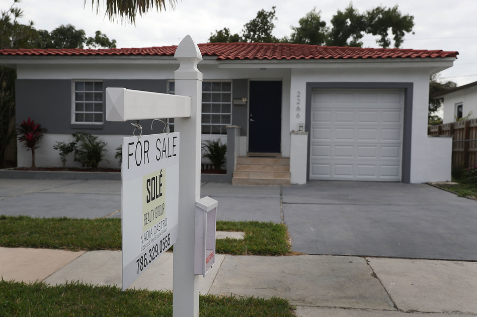 "A ""for sale"" sign is seen in front of a home in Miami on Jan. 24, 2018. The partial shutdown of the federal government is causing some financial problems for furloughed workers who can't refinance their mortgages or buy homes because lenders can't verify their income. (Joe Raedle/Getty Images)"
