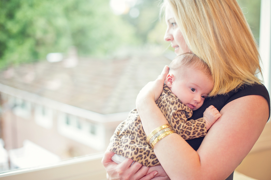 Lisa Abramson holds her firstborn child, Lucy, in 2014. A few weeks after Lucy's birth, Abramson began feeling confused and then started developing delusions — symptoms of postpartum psychosis. (Courtesy of Claire Mulkey)