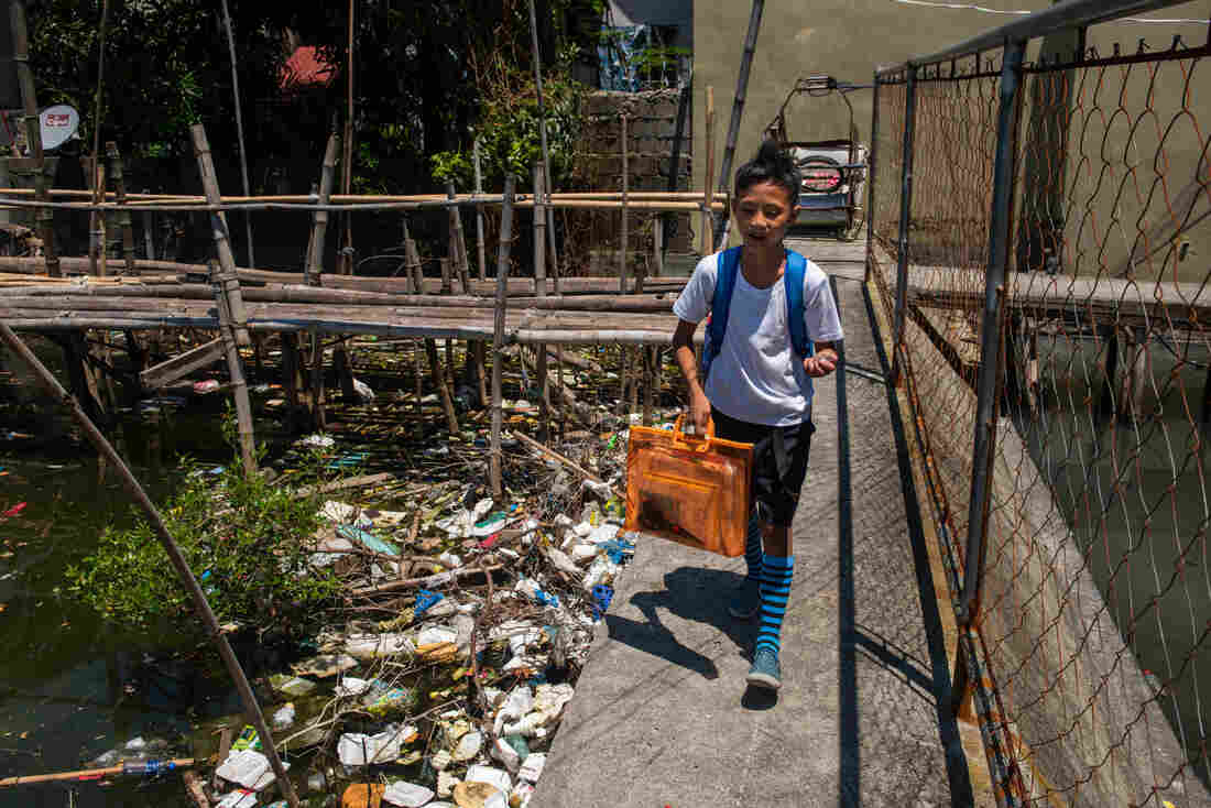 student-walking-to-school-trash-community
