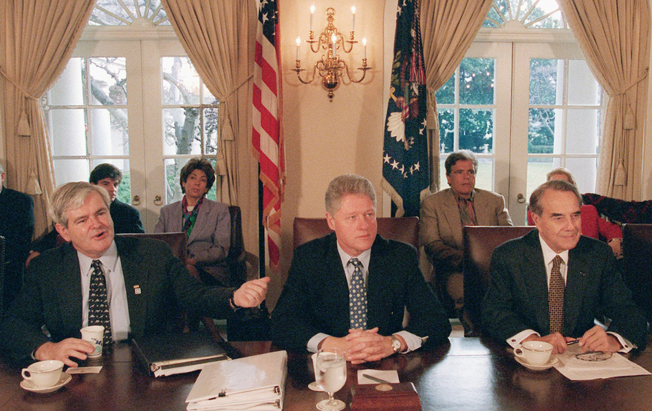 Then-House Speaker Newt Gingrich gestures toward President Bill Clinton, as then-Senate GOP leader Bob Dole sits to the right. They met to try to work through the government shutdown in late 1995 to early 1996. (Greg Gibson/AP)