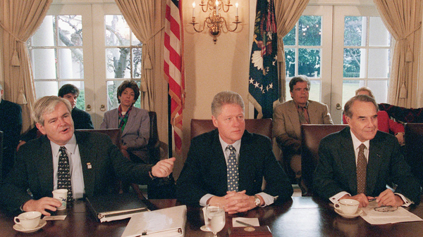 Then-House Speaker Newt Gingrich gestures toward President Bill Clinton, as then-Senate GOP leader Bob Dole is to the right. They met to try and work through the government shutdown in 1995.