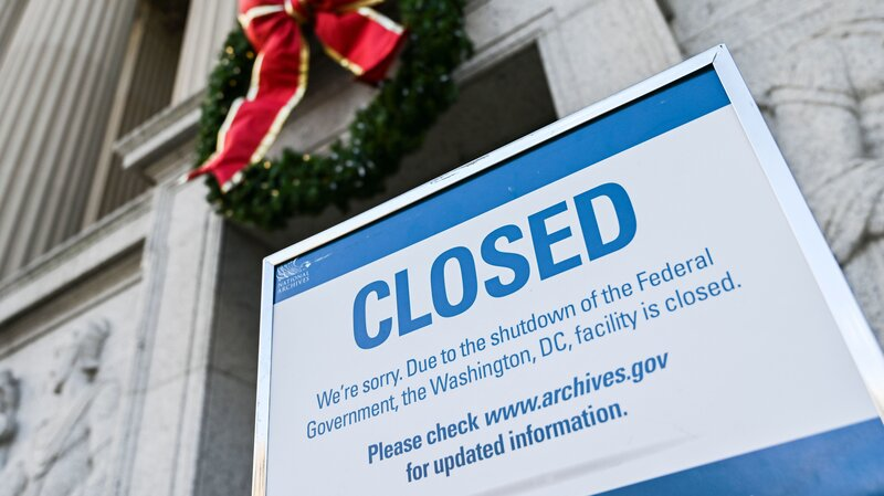 whatever it takes government workers apply for unemployment as shutdown drags on a sign outside the national archives in washington dc