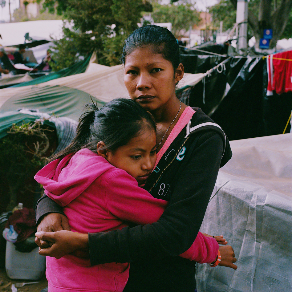 "Karen Paz hugs her daughter, Liliana Saray, 9. They are from San Pedro Sula, Honduras. ""I feel free; I feel different,"" Paz said. ""I don't have someone who imposes his views and his ways on me. I am not scared someone will come and attack me, like I used to be."" <em> </em> (Federica Valabrega)"