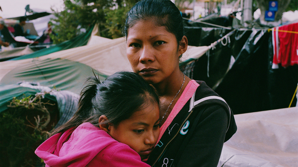 """Karen Paz hugs her daughter, Liliana Saray, 9. They are from San Pedro Sula, Honduras. """"I feel free; I feel different,"""" Paz said. """"I don"""