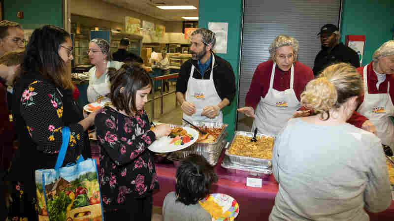 Furloughed Workers In Hard-Hit Community Gather For Potluck During Shutdown
