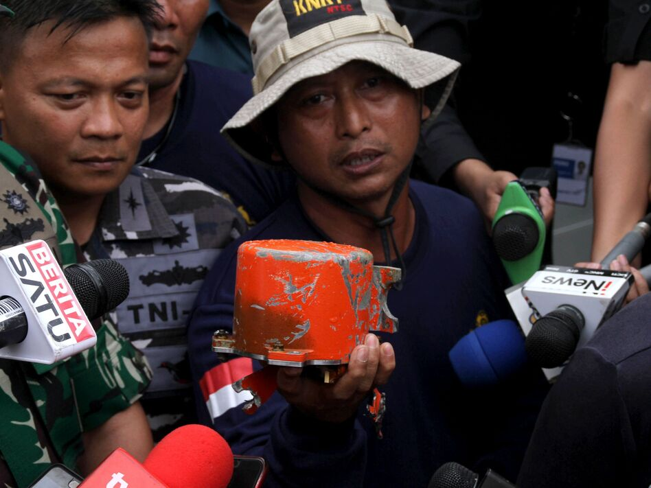 The cockpit voice recorder from Lion Air Flight 610 is displayed by Indonesian navy personnel after the device's recovery on Monday. (Azwar Ipank/AFP/Getty Images)