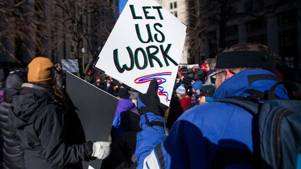 Demonstrators protest against the government shutdown in Boston on Friday.
