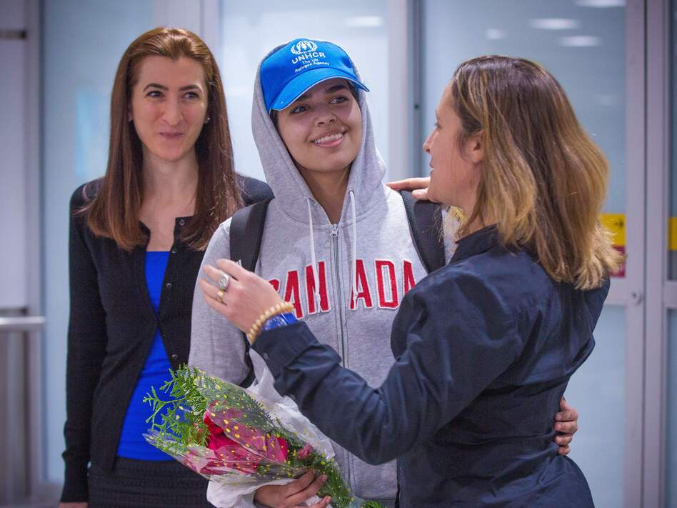 Rahaf Mohammed Alqunun (center) is welcomed by Canadian Minister for Foreign Affairs Chrystia Freeland as she arrives at Pearson International Airport in Toronto, Ontario, on Saturday. The young Saudi woman who fled her family successfully harnessed the power of Twitter to secure asylum in Canada. (Lars Hagberg  /AFP/Getty Images)