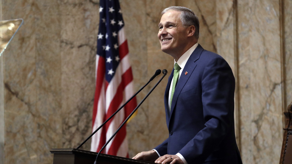Washington Gov. Jay Inslee gives his State of the State address to a joint session of the Legislature on Jan. 15, 2019, in Olympia, Wash. (Elaine Thompson/AP)