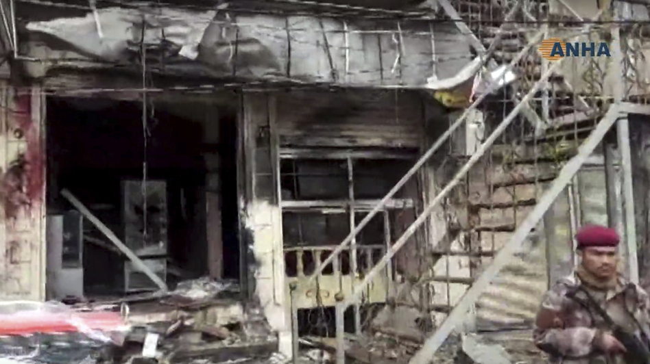 An explosion damaged a restaurant in Manbij, Syria, Wednesday, shown in a screengrab from the Kurdish Hawar News agency, or ANHA.