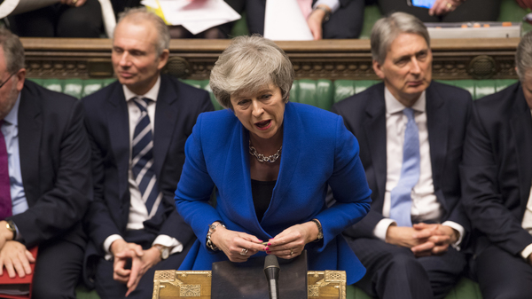 British Prime Minister Theresa May speaks Wednesday during a debate before the no-confidence vote raised by opposition Labour Party leader Jeremy Corbyn, in the House of Commons in London.