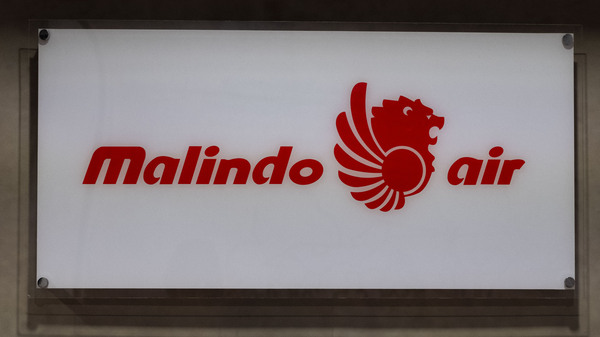 Malindo Air said it is cooperating with authorities after at least one of its cabin crew members was arrested in Australia for allegedly taking part in an international drug smuggling ring.