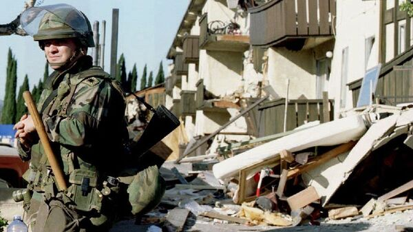 A National Guardsman stands guard outside the ruins of the Northridge Meadows Apartments where 16 people died during the January 1994 earthquake that rocked Southern California. Since then, many of these kinds of apartments have been retrofitted to withstand a large quake.