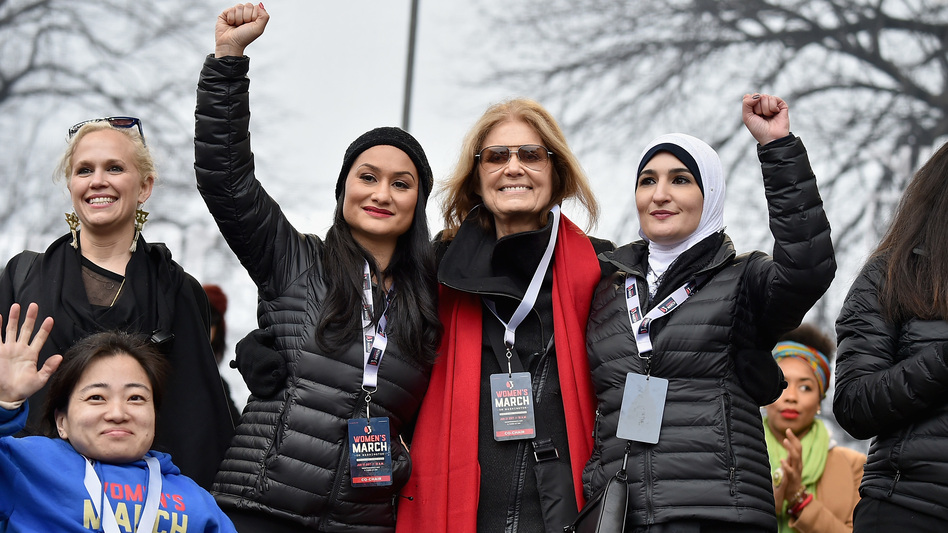 Ginny Suss, Carmen Perez, Gloria Steinem, Linda Sarsour and Mia Ives-Rublee appear at the first Women's March in Washington, D.C., the day after President Trump's 2017 inauguration. Two years later, divisions in the movement have dampened the 2019 events. (Theo Wargo/Getty Images)