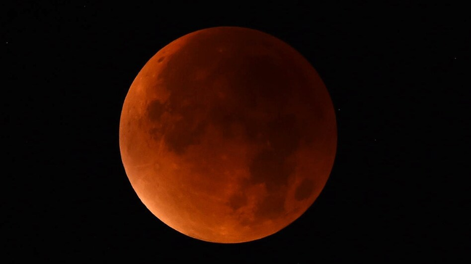 """A """"blood moon"""" seen from western Germany during a total lunar eclipse on Sept. 28, 2015."""