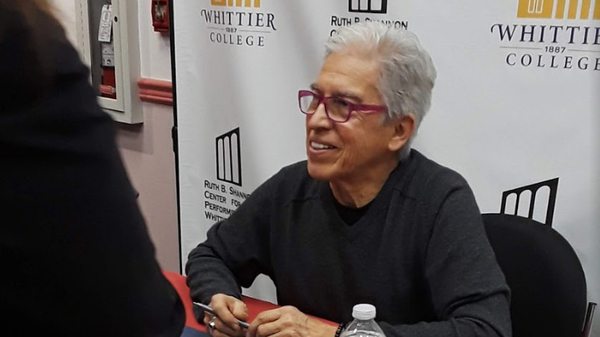 Louie Peréz at a book signing for Good Morning, Aztlán: The Words, Pictures and Songs of Louie Perez.