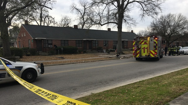 Emergency crews responded to the Allen Benedict Court public housing complex in Columbia, S.C., Thursday. They found two men dead in the morning and later discovered gas leaks in multiple buildings.