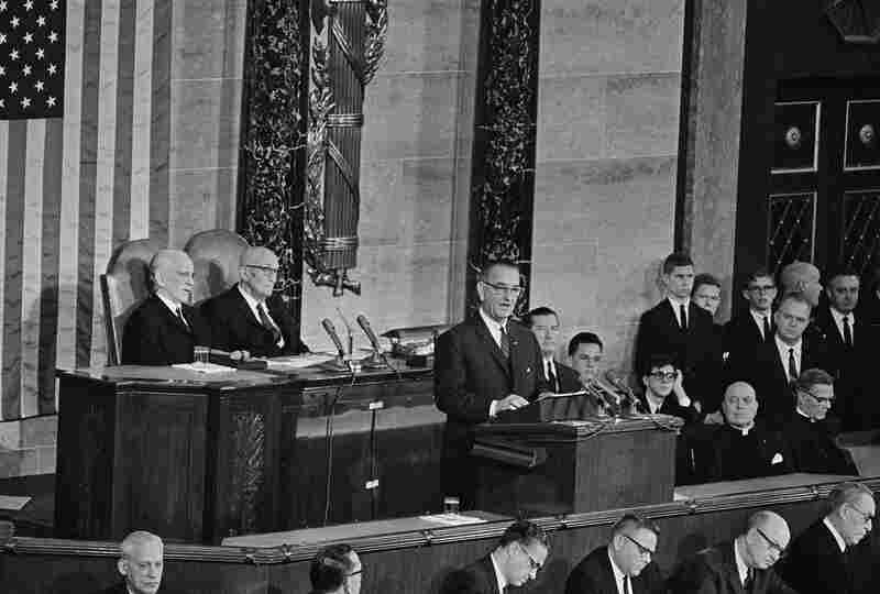 "President Lyndon B. Johnson delivers his State of the Union address to a joint session of Congress in 1964. Speaking in the House of Representatives, the chief executive said one of his aims was ""unconditional war on poverty in America."""