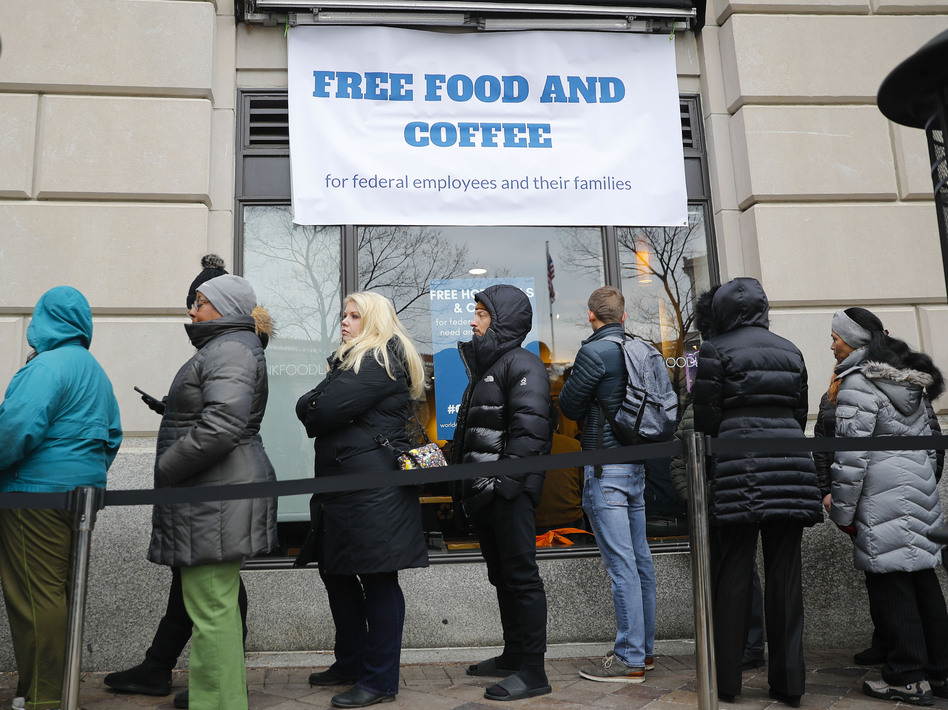 People wait in line at Chef Jose Andres' World Central Kitchen for free meals to workers affected by the government shutdown in Washington, DC. (Pablo Martinez Monsivais/AP)