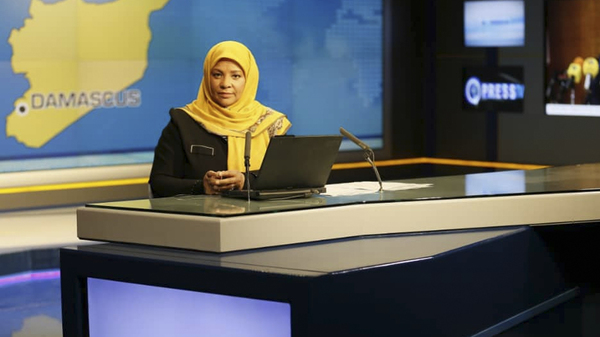 American-born news anchor Marzieh Hashemi sits in a studio in Tehran where she works for Iran