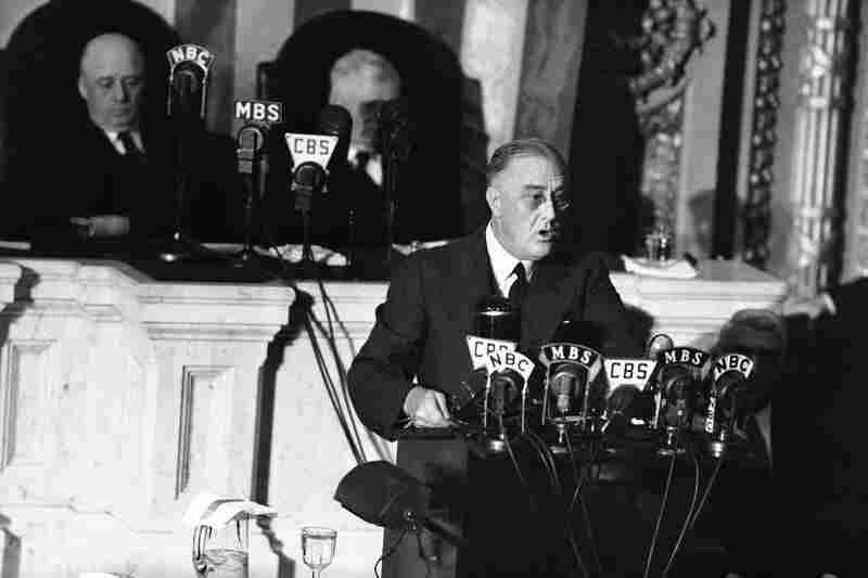 "President Franklin D. Roosevelt adresses a joint session of Congress as Speaker Sam Rayburn, left, and Vice President John N. Garner, look on. With World War II looming, Roosevelt used his 1941 address to outline the ""four freedoms,"" freedom of speech, freedom of worship, freedom from want and freedom from fear."