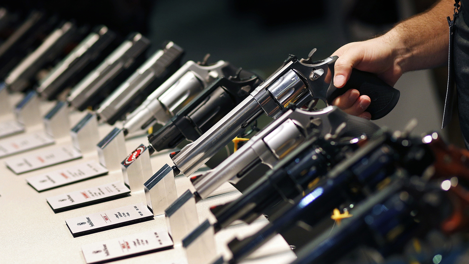 Handguns are displayed at a trade show in Las Vegas. The Supreme Court is granting a case on gun rights for the first time since 2010. (John Locher/AP)