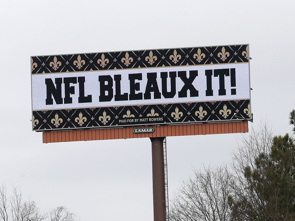 Saints fans aren't happy with the NFL after a controversial no-call in Sunday's NFC championship game. One fan took out several billboards around Atlanta with his message for the league. (John Bazemore/AP)
