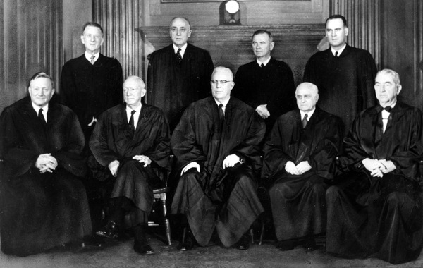 Justices of the U.S. Supreme Court pose for a portrait in their robes in Washington in 1958. Standing at left is Justice Charles Whittaker, who resigned from the court after having a nervous breakdown.