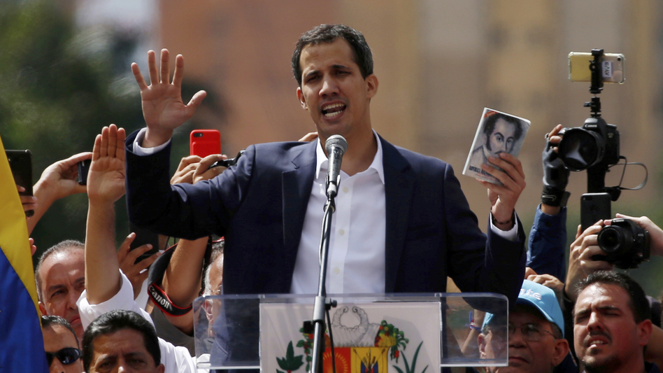Juan Guaidó, head of Venezuela's opposition-run congress, declares himself interim president of Venezuela during a rally against President Nicolás Maduro in the capital, Caracas, on Wednesday. (Fernando Llano/AP)