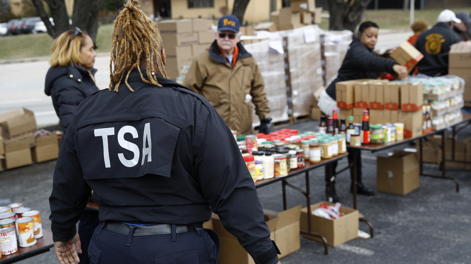 A TSA employee visits a Baltimore food pantry for government workers affected by the federal shutdown. (Patrick Semansky/AP)