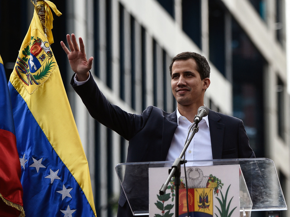 Venezuela's National Assembly head Juan Guaidó waves during a mass opposition rally, during which he declared himself the country's acting president on Jan. 23. (Federico Parra/AFP/Getty Images)